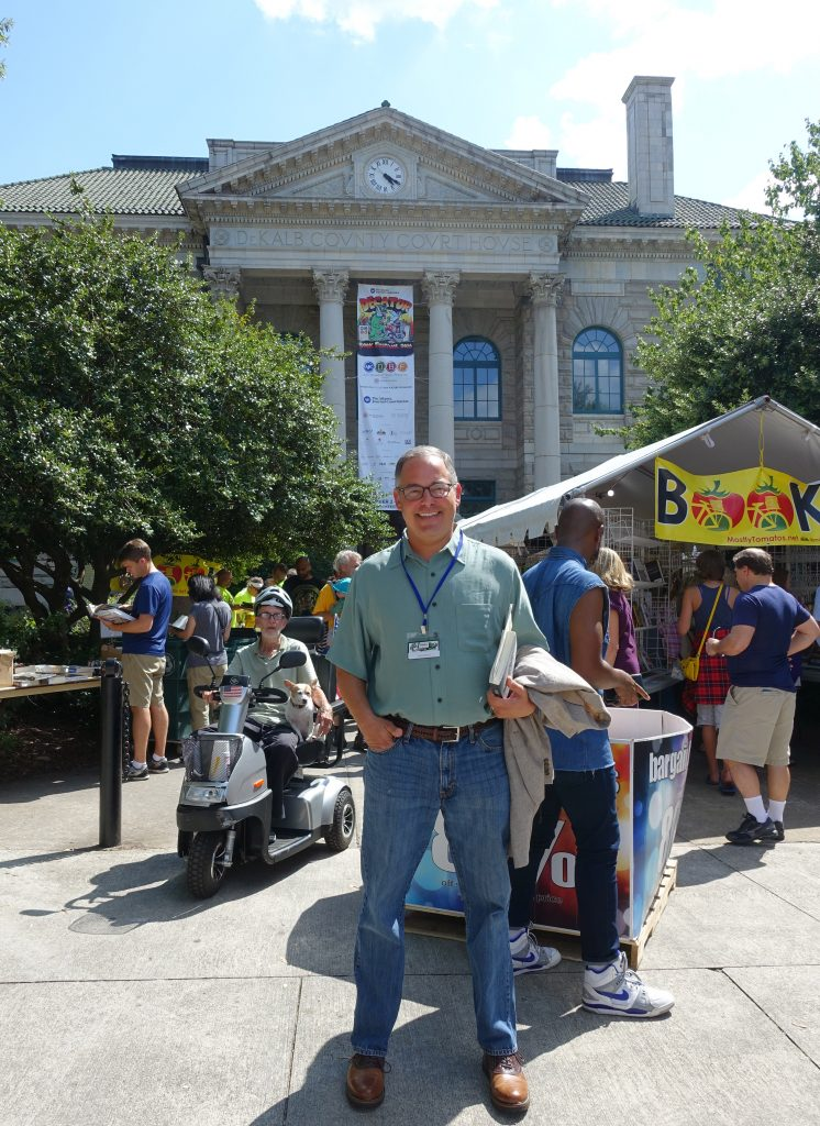 Ted Geltner standing in front of The Old Courthouse, where his event took place Sunday afternoon