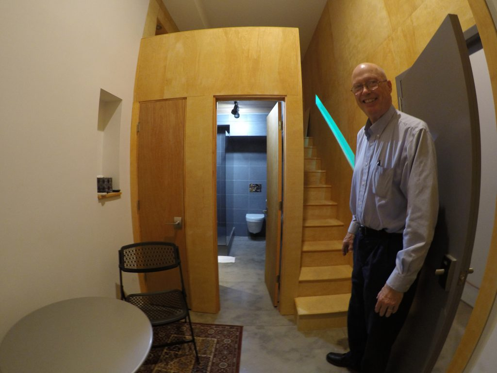 Mike Orenduff gives a tour of the AirBnB room inside the bookstore