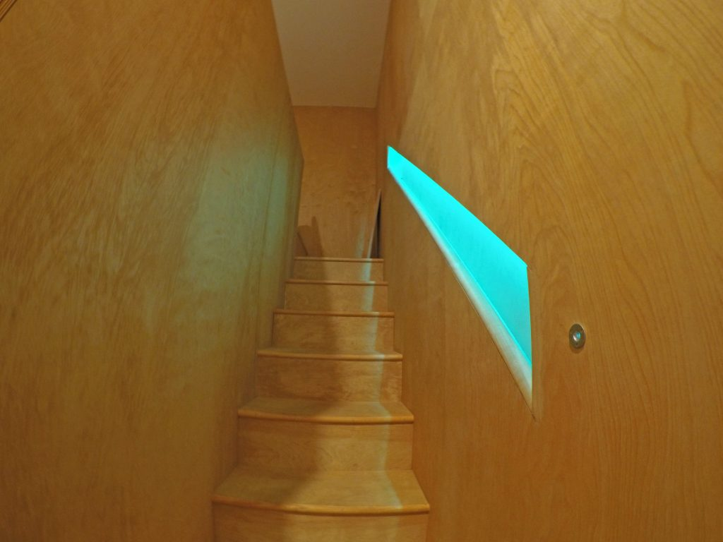 Stairs leading up to the bed