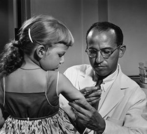Dr. Jonas Salk administering a vaccine in the 1950s.