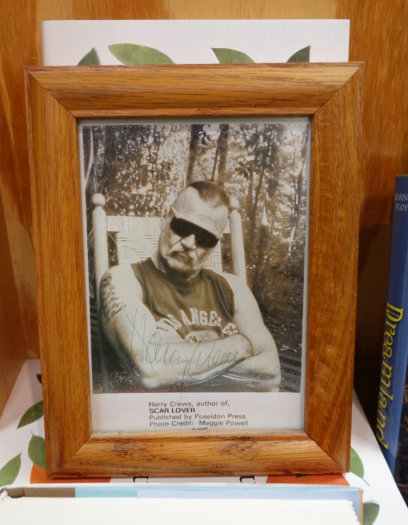 The framed '90s publicity shot of Harry Crews that graces the wall at Lemuria Books