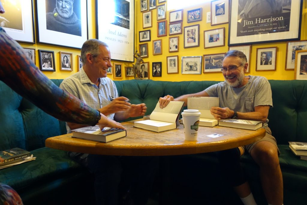 Ted Geltner autographing copies of Blood, Bone, and Marrow for Lemuria Books owner John Evans