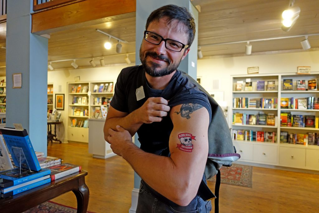 Taylor Brown, author of The River of Kings, showing off his Blood, Bone, and Marrow tattoo