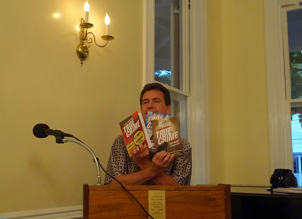 Terry Schmida shows off his books